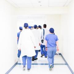 Doctors walking down hallway